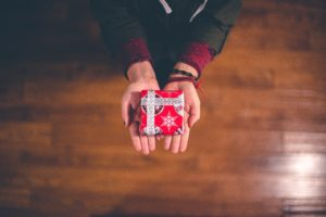 a wrapped gift in hands